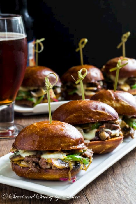 Philly Cheese Steak Sliders - {RECIPE ABOVE} Savory Philly Cheese Steak Sliders with beef, gooey melted cheese and the fixin's. Serve as an appetizer or as the main star for Father's Day.