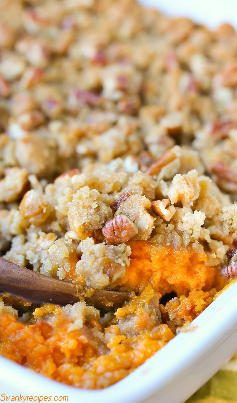 Serve up this classic Sweet Potato Casserole made with fresh sweet potatoes, sugar, butter and spices. This crunchy buttery, brown sugar and pecan topping served in this casserole is the ultimate staple side dish. It's the perfect side dish for Thanksgiving and Christmas holiday parties.