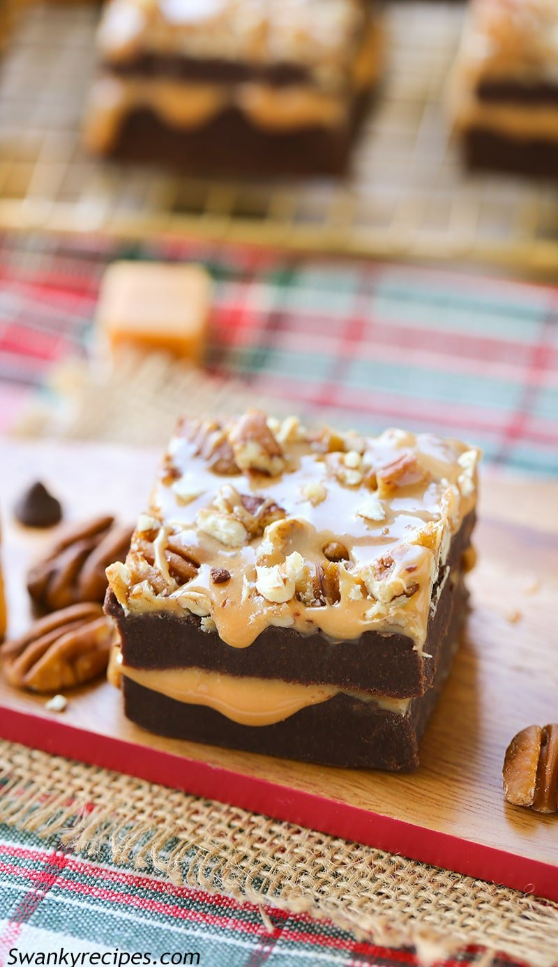Turtle Fudge - Salted caramel sauce stuffed between two layers of rich chocolate fudge. Garnished with pecans and drizzled with caramel sauce and sea salt. A decadently rich fudge that will have heads spinning.