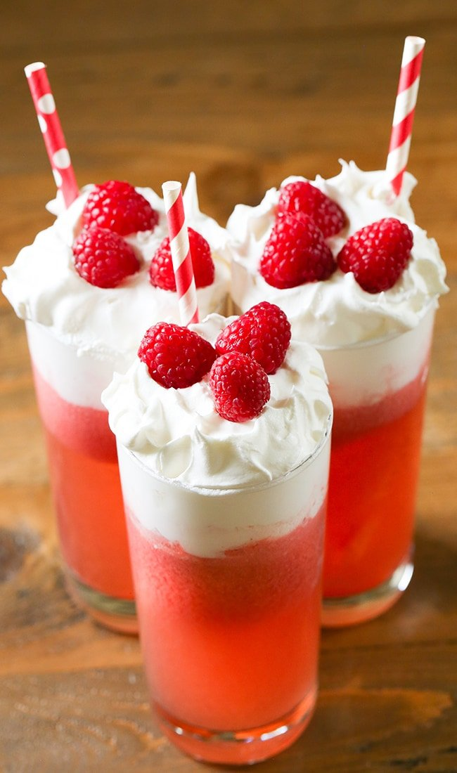 Italian Cream Soda - A fizzy beverage made with sparkling club soda, pineapple juice, Torani Raspberry Syrup, and cream.  Topped with whipped cream and fresh fruit, this drink will quickly become a favorite.