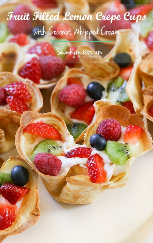Fruit Filled Lemon Crepes with Coconut Whipped Cream - Muffin tin lemon crepes filled with homemade coconut whipped cream topping. Garnished with fresh fruit and powdered sugar. Serve for breakfast, brunch or dessert.