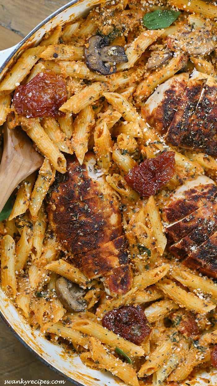 Chicken Mozzarella Pasta with Sun-Dried Tomatoes - Pan seared sun-dried tomatoes and oven-roasted chicken with sauteed mushrooms, garlic, and spinach added to a rich and flavorful creamy mozzarella marinara sauce with penne pasta.  Pan tossed with parmesan cheese and herbs to give a robust Tuscan flavor.  This recipe will become a family favorite.