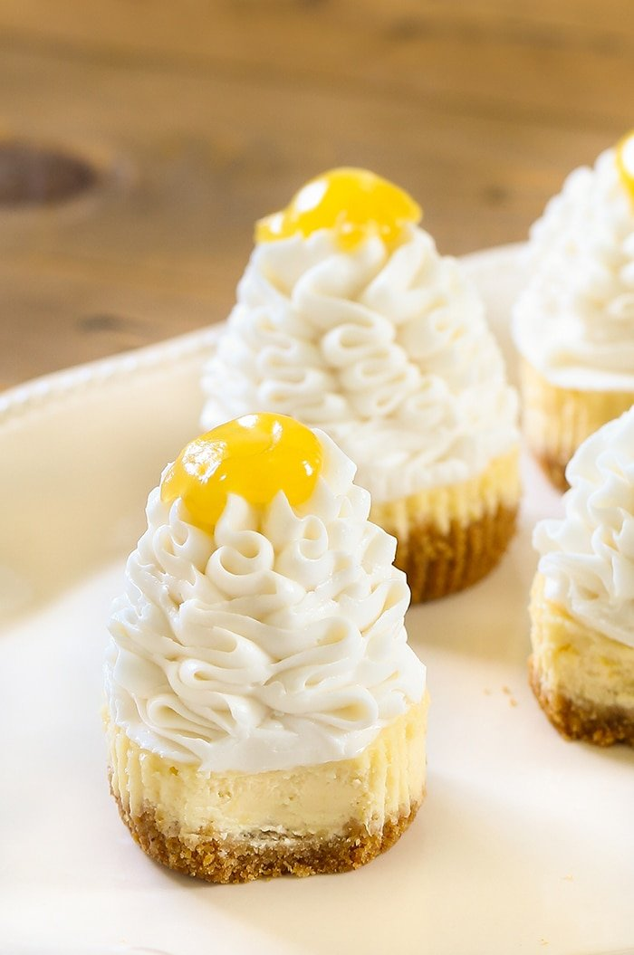 Lemon Cheesecake Cupcakes - A creamy and tart cheesecake dessert that combines the zing of fresh lemons and sweetened cream cheese.