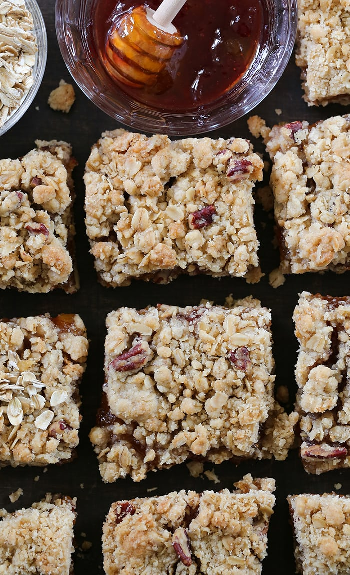 Strawberry Fig Oatmeal Crumble Bars - A delicious combination of strawberry and fig jam with a buttery oat and pecan crust with streusel topping. Now made with less added sugar, these oatmeal jam bars featuring SPLENDA® Naturals Sugar & Stevia Sweetener Blend are the perfect snack to savor all summer long.