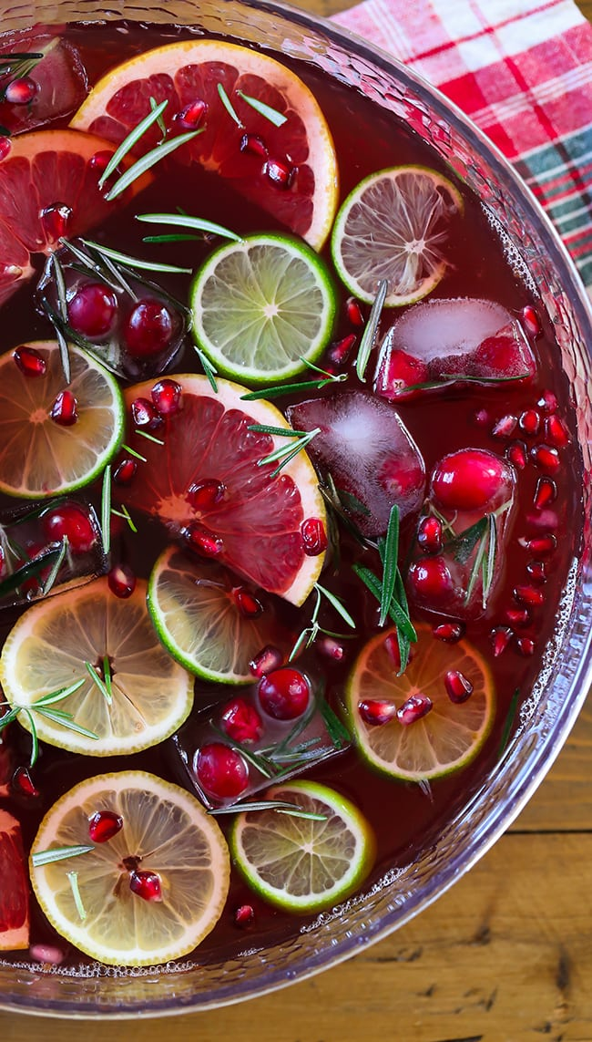 Jingle Juice Holiday Punch - Swanky Recipes - Made with sweet tea, lemonade and cranberry juice. You'll love this holiday drink recipe. #holidaypunch