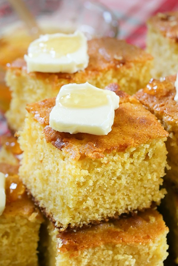 Sweet Buttermilk Cornbread - Serve up this classic southern dish of Sweet Buttermilk Cornbread.  Made with warm butter, sugar, cornmeal and other classic ingredients.  Once you try this easy to make fall dish, you'll never go back to a boxed version again!