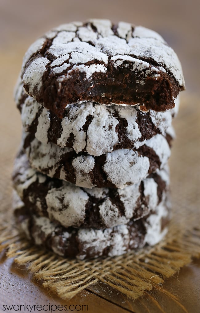 Chocolate Crinkle Cookies - Chewy chocolate cookies that will melt in your mouth. These cookies feature a secret flavor that you'll love for the holiday season. #cookies #christmas