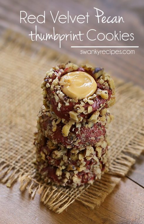 Red Velvet Thumbprint Cookies - The ultimate holiday cookies; these Red Velvet Thumbprint Cookies are coated in chopped pecans.  Each center is filled with caramel cream cheese.  These make the perfect dessert for any holiday spread or winter gift. #cookies