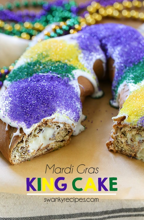 Cream Cheese King Cake - Celebrate Mardi Gras with this cream cheese stuffed King Cake.  This New Orleans classic tastes just like a cinnamon roll and features a thick icing with vibrant purple, gold and green sanding sugar. #kingcake #NewOrleans #MardiGras