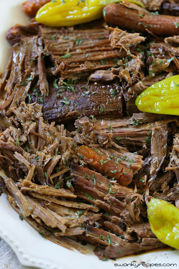 Slow Cooker Mississippi Ranch Pot Roast is the most delicious pot roast you'll ever eat! Flavorful, rich and made with few ingredients. You've never had a crockpot roast like this before! Serve roast with rice or mashed potatoes. #slowcooker #crockpot #roast