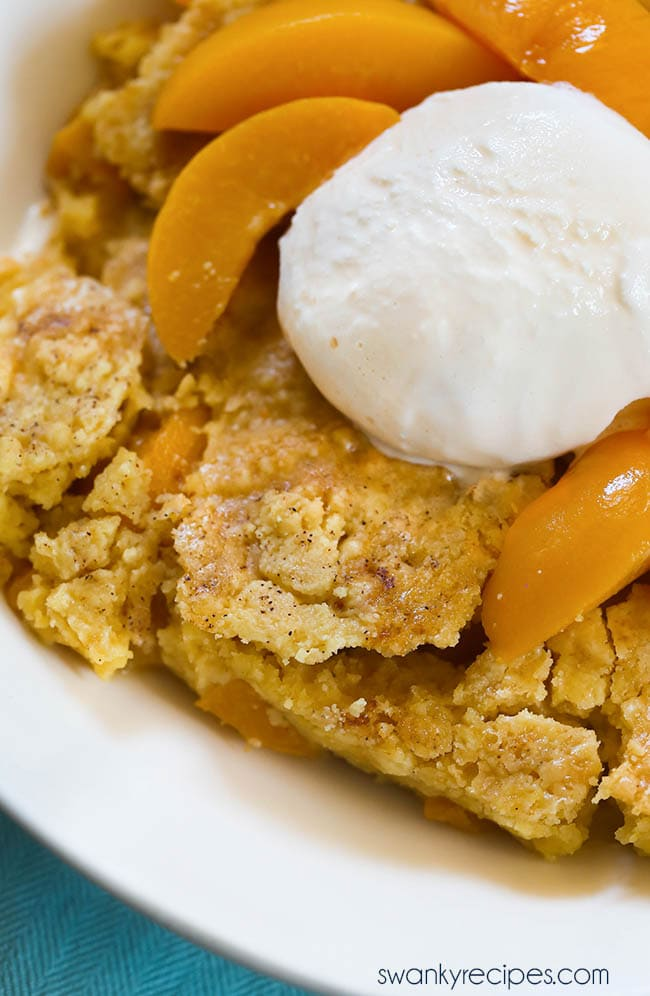 Peach Cobbler Dump Cake - Hands down, the easiest cake this summer with just 3 ingredients! We love this cake mix cobbler for summer cookouts, graduation parties, 4th of July and summer holiday parties. #cobbler #dumpcake #cake #summerdesserts