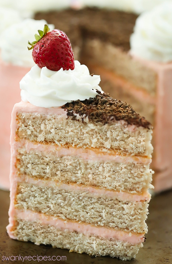 Strawberry Layer Cake - Hands down, the best fresh strawberry cake with moist crumb and slightly sweet cake layers between strawberry buttercream frosting. Everyone raves how delicious this cake is year round. Serve strawberry cake as a dessert during summer or as a birthday cake! #layercake #strawberry #cake