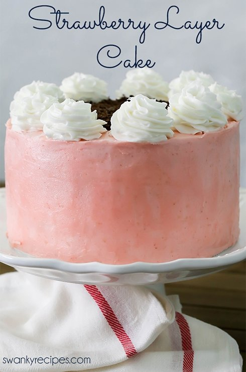 Strawberry Layer Cake - Hands down, the best fresh strawberry cake with moist crumb and slightly sweet cake layers between strawberry buttercream frosting. Everyone raves how delicious this cake is year round. Serve strawberry cake as a dessert during summer or as a birthday cake!