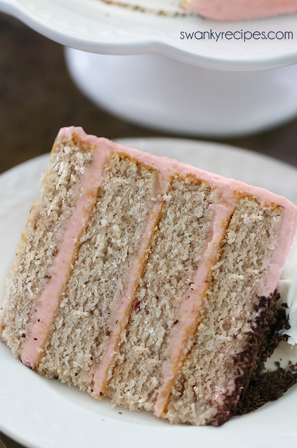 Strawberry Layer Cake - Hands down, the best fresh strawberry cake with moist crumb and slightly sweet cake layers between strawberry buttercream frosting. Everyone raves how delicious this cake is year round. Serve strawberry cake as a dessert during summer or as a birthday cake! #cake #strawberry #dessert