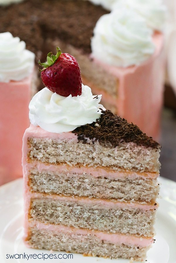 Strawberry Layer Cake - Hands down, the best fresh strawberry cake with moist crumb and slightly sweet cake layers between strawberry buttercream frosting. Everyone raves how delicious this cake is year round. Serve strawberry cake as a dessert during summer or as a birthday cake! #strawberry #cake #dessert