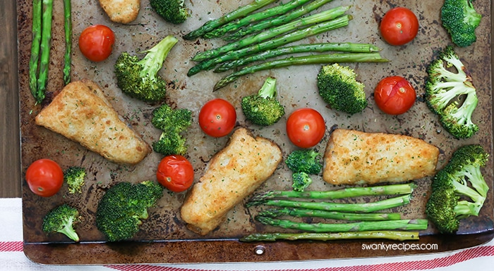 Sheet Pan Fish and Vegetables - One pan crispy beer battered fish fillets with glazed honey garlic roasted vegetables.  An easy 30-minute sheet pan meal the whole family will love. #sheetpan #onepot