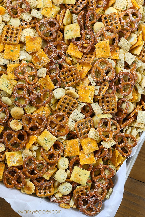 Ranch Chex Mix made for a crowd. My favorite snack mix is loaded with peanuts, cheese crackers, pretzels, and rice cereal. This easy zesty Ranch Chex Mix is perfect for parties and school lunches.