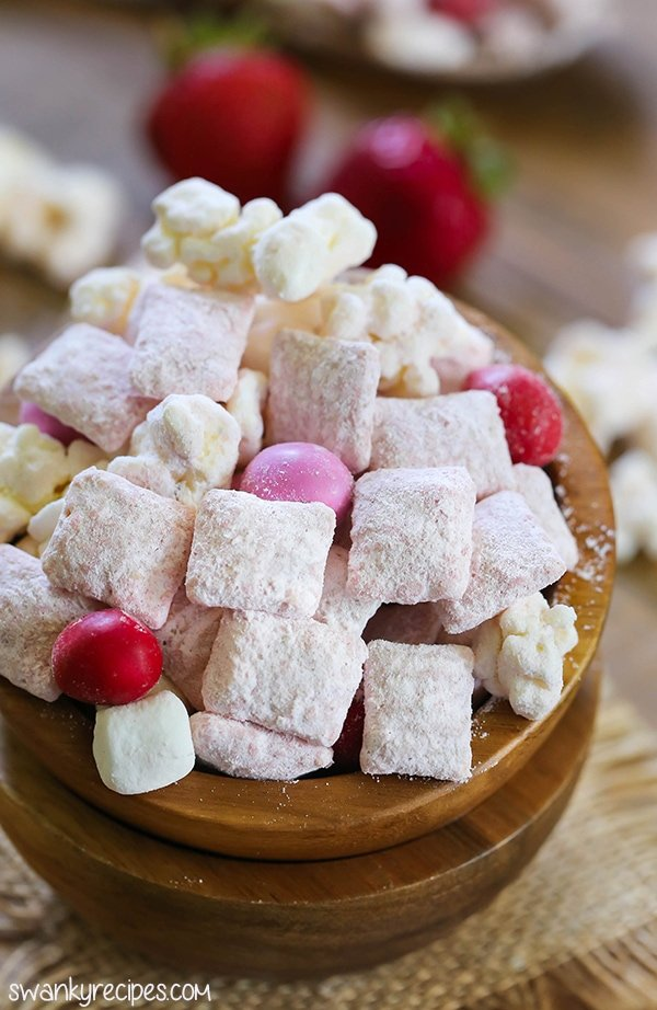Strawberry Shortcake Muddy Buddies - Gourmet strawberry flavored popcorn and rice cereal snack mix. Everyone loves this easy strawberry dessert snack.