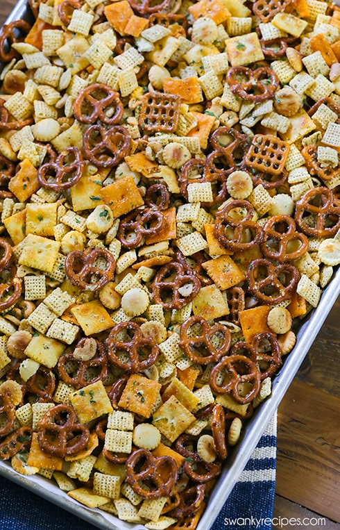 Italian Chex Mix made for a crowd. My favorite snack mix is loaded with peanuts, cheese crackers, pretzels, and rice cereal. This easy zesty Italian Chex Mix is perfect for parties and school lunches. #snackmix #chexmix #partyfood