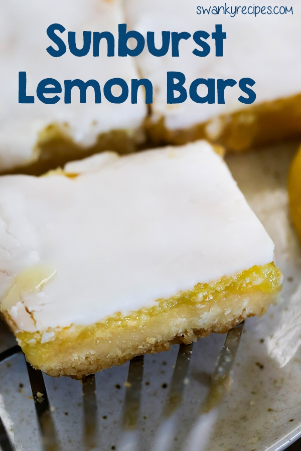Sunburst Lemon Bars - Sweet Citrus Lemon Filling with almond shortbread cookie crust. Everyone raves how rich and delicious these lemon bars are! Easy to make lemon bar dessert!