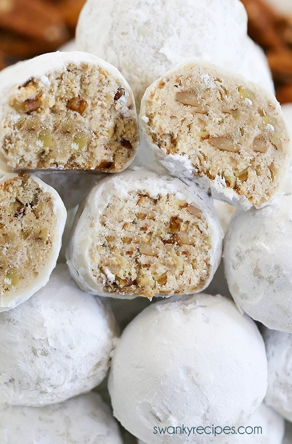 Pecan Snowballs - This 7-ingredient easy pecan snowball cookie recipe is a holiday classic and deserves a spot on your holiday cookie tray! A new improved version! Buttery vanilla shortbread cookies with ground pecans the whole family will love!