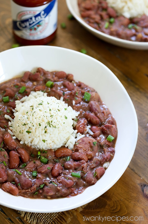 Red Beans and Rice - A taste of the French Quarter. Authentic New Orleans Red Beans and Rice made with Andouille Sausage, ham, Creole seasoning, and rice. This Red Beans and Rice recipe is authentic and the real deal. Do what the locals do and serve this on a Monday!