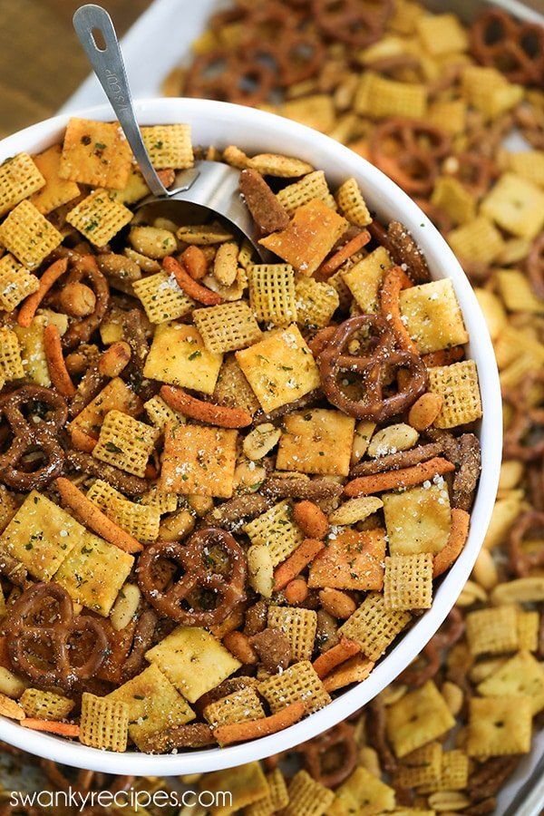 Cajun Chex Mix - For a taste of Cajun Country in Louisiana, try this spicy Cajun seasoning snack mix blend. Made with local Creole and Cajun seasoning from New Orleans, and pretzels, Cajun corn sticks, chex cereal, cheese crackers, and nuts. Everyone raves how amazing and easy this Chex Mix is.