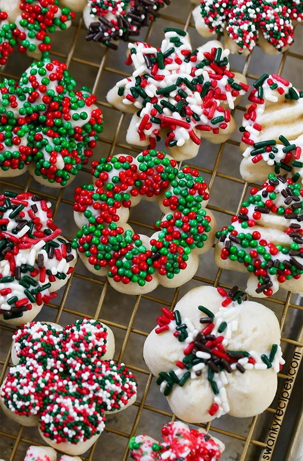 Spritz Cookies - Christmas cookies decorated with holiday sprinkles. A classic favorite that everyone loves!