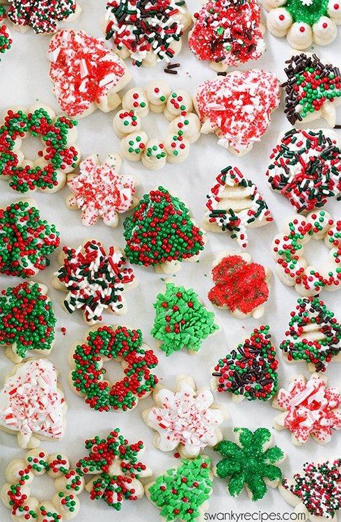 Spritz Cookies - Buttery, Christmas sprinkle topped cookies. These cookies are fun to get the kids involved in.