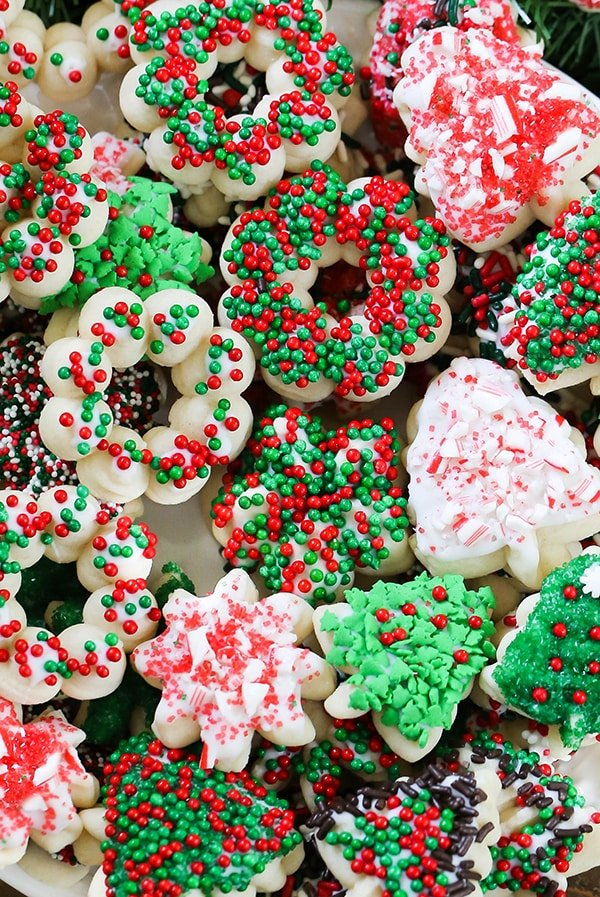 Spritz Cookies - Classic, buttery spritz cookies decorated with Christmas sprinkles. These cookies have been around forever and are the #1 symbolic Christmas cookie to make.
