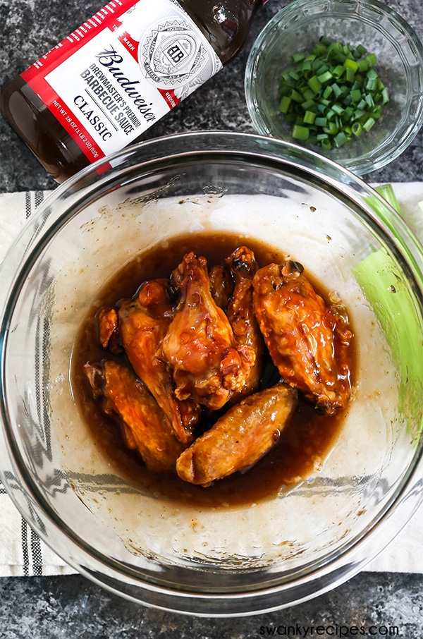 Easy Apricot BBQ Chicken Wings - The BEST barbecue chicken wings with apricot jam. Just a few ingredients for easy crispy oven-baked chicken wings.