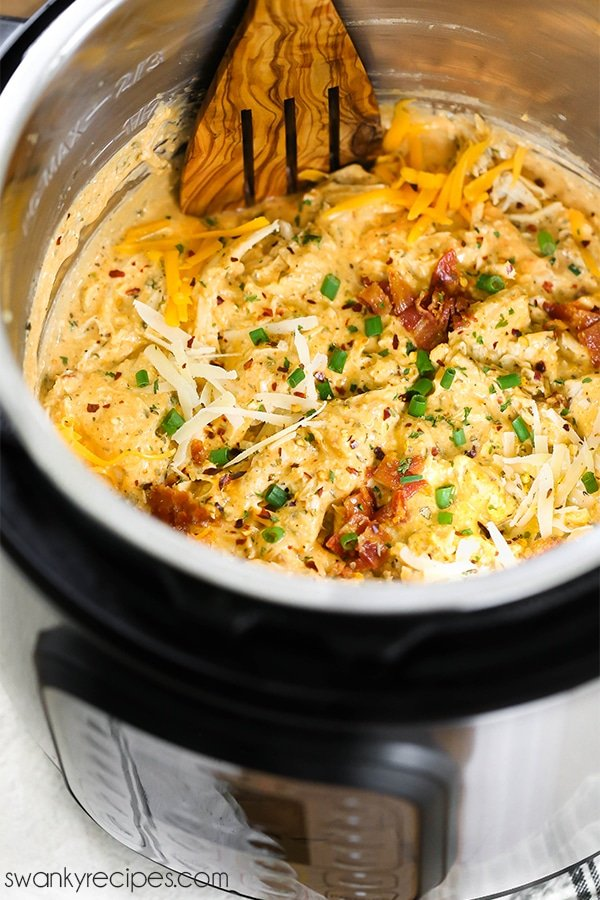 Crack Chicken made in the Instant Pot pressure cooker. Shredded chicken in a ranch and cheese sauce with bacon.