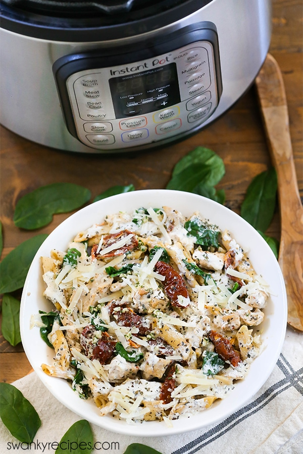 Instant Pot Tuscan Chicken Pasta - The BEST pasta recipe made in the Instant Pot. A quick 5 minutes for a complete Italian pasta meal.
