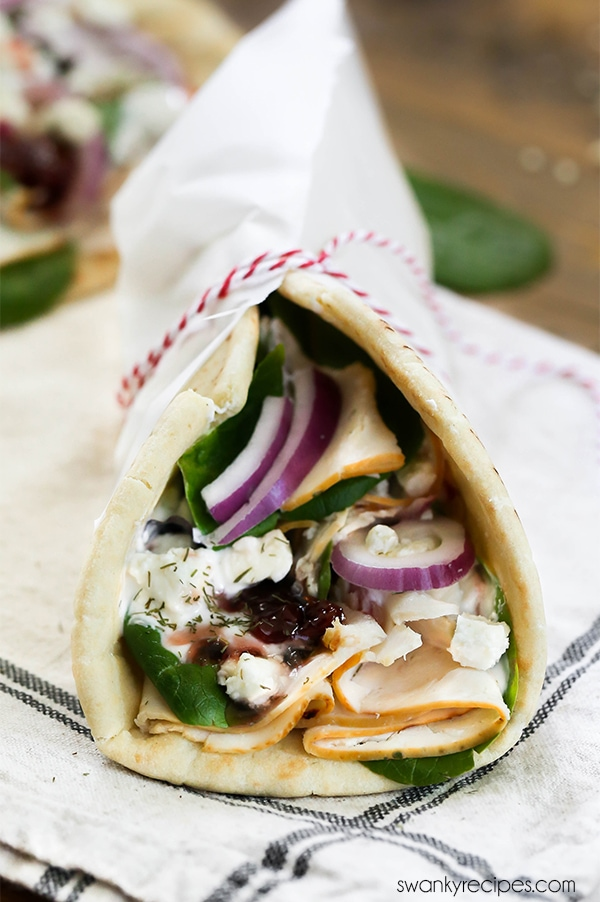 Greek Chicken Gyros with pita bread and Tzatziki Sauce.
