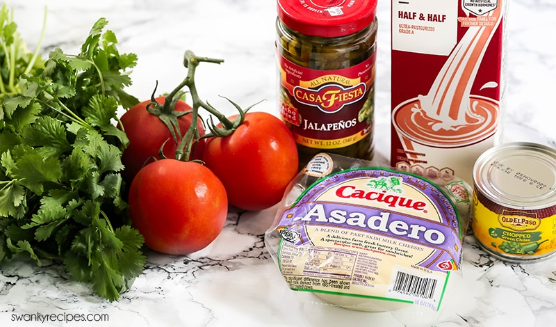 Queso Dip Ingredients that use Asadero Mexican Cheese, jalapenos, green chiles, milk, and cilantro.