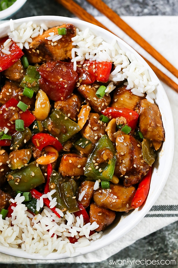 Kung Pao Chicken with spicy Kung Pao sauce. A Chinese chicken recipe made with vegetables and rice.