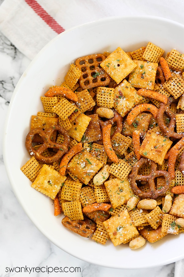 Buffalo Ranch Chex Mix - A spicy blend of buffalo sauce and ranch seasoning baked with snack crackers.
