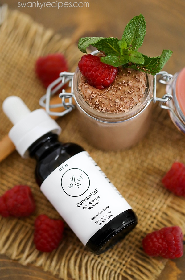 Lokus CBD oil next to a small jar of CBD infused chocolate mousse.