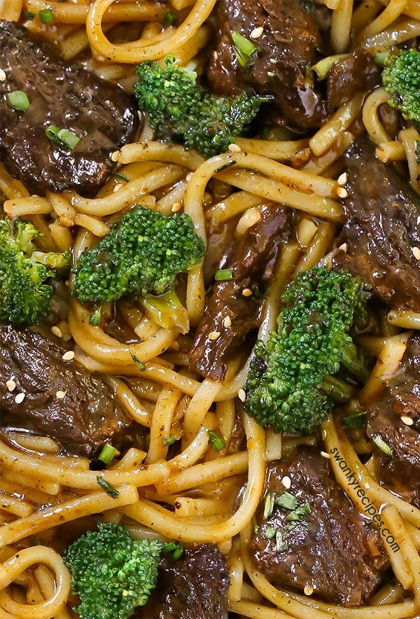 Beef and Broccoli made from scratch and served over rice noodles and tossed in a savory Chinese sauce.