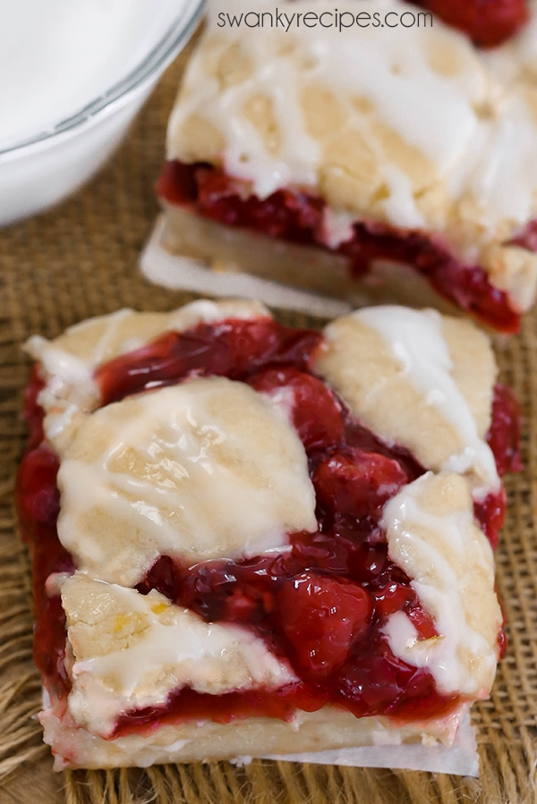 Cherry pie bars with a crumbly vanilla crust. The perfect kuchen bars will cherry filling.