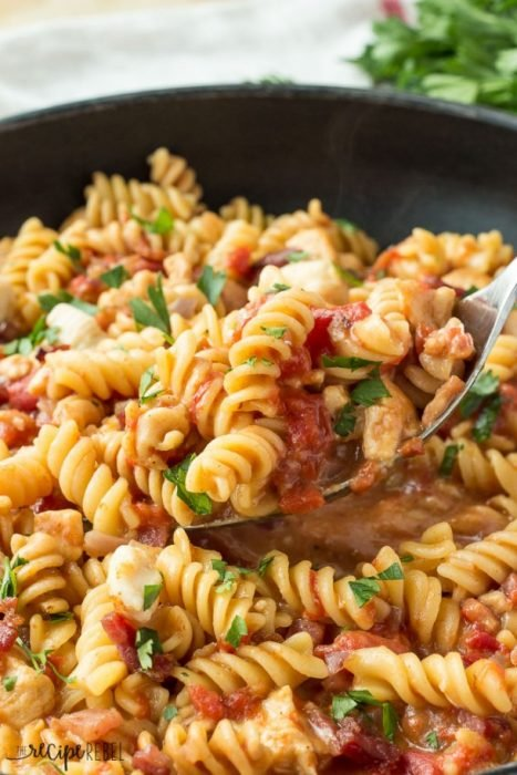 One Pot Bacon BBQ Chicken - Pasta lover's will love this BBQ Chicken Pasta made with bacon and fresh herbs. Made in one pot, this recipe is fuss free and one our family makes over and over again.