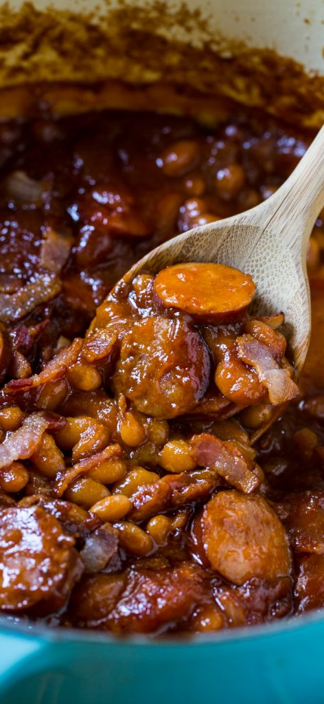 Baked Beans with Sausage - Every backyard cookout needs homemade Baked Beans. This recipe features sausage and is cooked to perfection. Serve as a side dish for summer occasions.