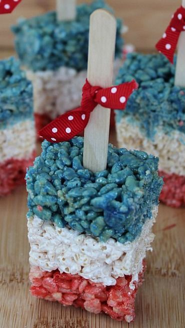 Patriotic Rice Krispy Treat Pops - Fun and timeless Patriotic Rice Krispy Treasts Pops are great to make with the kids for Memorial Day or July 4th.