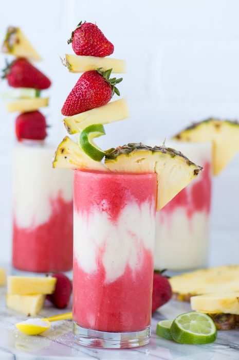 Pina Colada Mocktail - Cool down with virgin fresh fruit Pina Coladas during the holiday. Our family loves to make this fun and delicious beverage during the hot summer months.