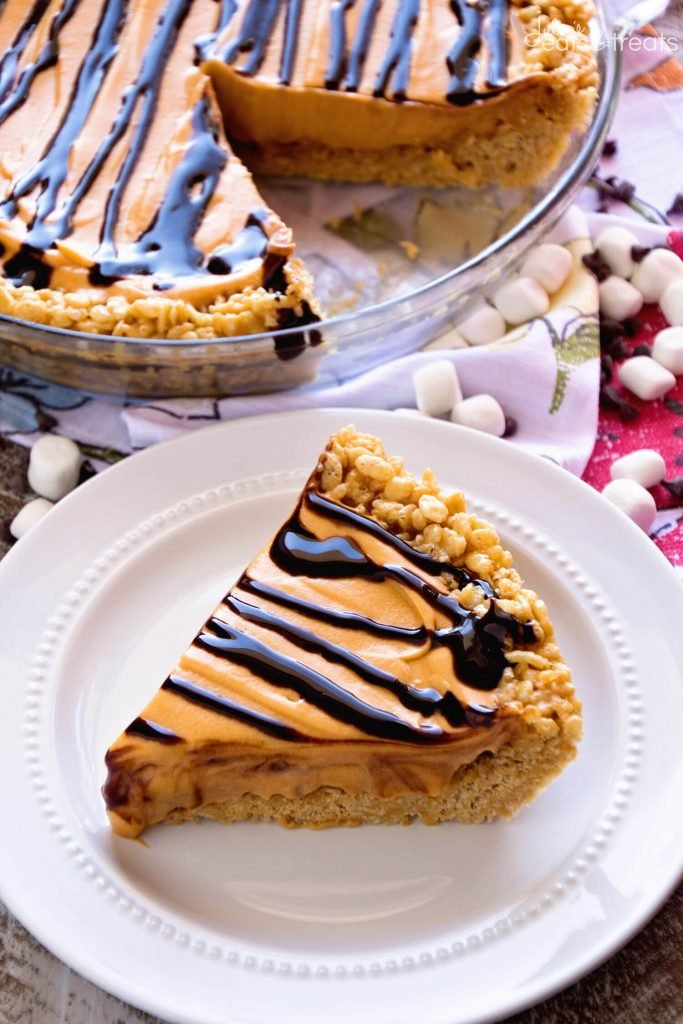 No Bake Scotcheroo Pie - {RECIPE ABOVE} Everyone will enjoy the delicious flavor of Scotcheroo Pie. If you're looking for a fun, no-bake pie to celebrate summer with, you'll want this recipe. It's perfect with a scoop of vanilla or chocolate ice cream.