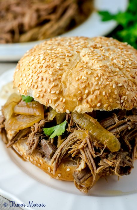 Slow Cooker Pulled Pork Sandwiches - {RECIPE ABOVE} Take is easy this Father's Day and make these Slow Cooker Pulled Pork Sandwiches. Pair it with pasta salad and a summery dessert for the ultimate menu.