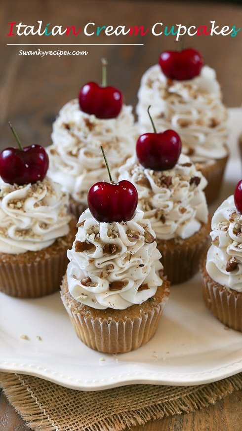 Italian Cream Cupcakes - Light, airy and rich vanilla buttermilk and almond cupcakes blended with sweetened coconut and pecans. Topped with the ultimate cream cheese and buttercream frosting with cherries and pecans.  These cupcakes will quickly become a family favorite.  Serve for the holidays or during summer months when fresh cherries are readily available.