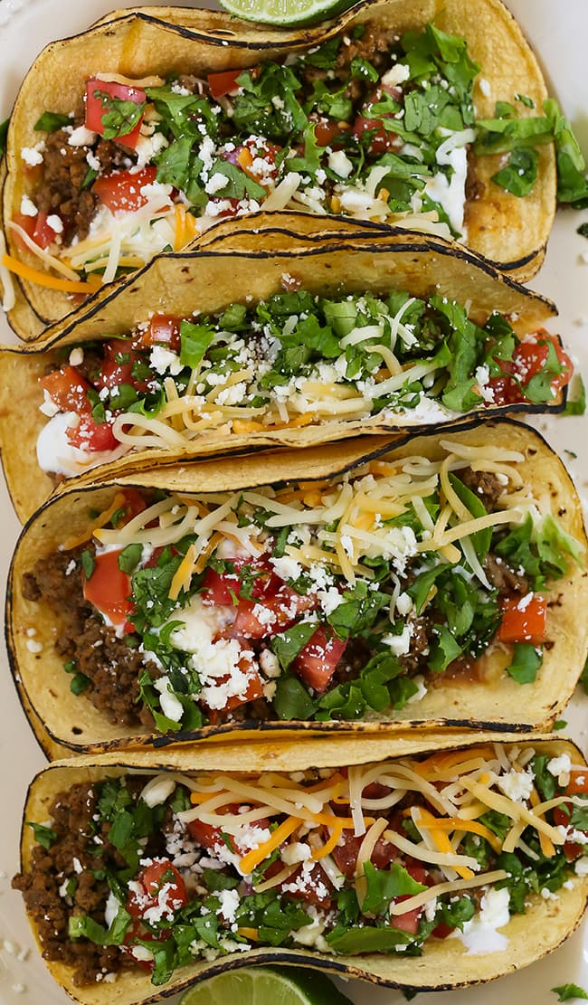 Easy Ranch Beef Tacos - Savory ground beef tacos made with a craveworthy ranch and taco seasoning sauce. These easy tacos are stuffed in fire-roasted corn tortillas with traditional Mexican toppings. The best way to make tacos for a busy weeknight dinner.