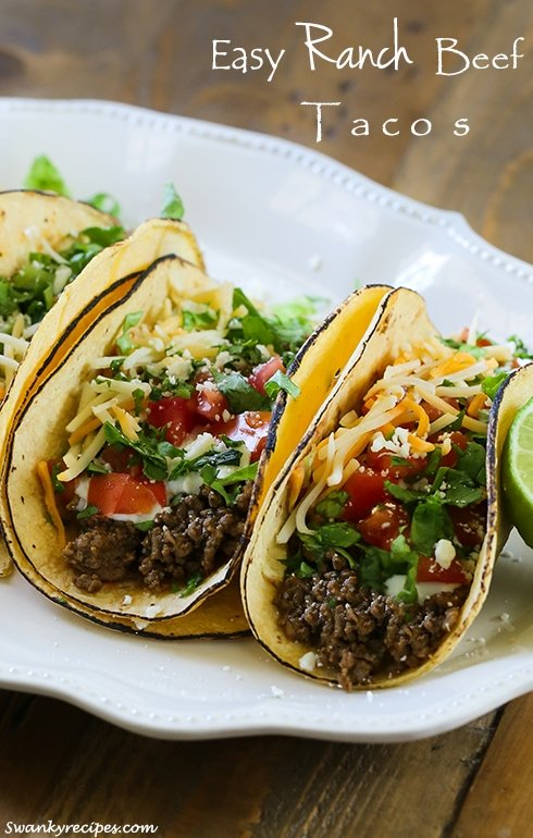 Easy Ranch Beef Tacos - Savory ground beef tacos made with a crave worthy ranch and taco seasoning sauce.  These easy tacos are stuffed in fire-roasted corn tortillas with traditional Mexican toppings. The best way to make tacos for a busy weeknight dinner.