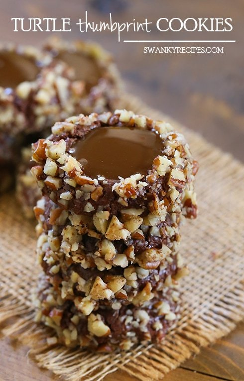 Turtle Thumbprint Cookies - Decadently rich chocolate sugar cookies with a caramel filling and toasted pecans.  These cookies have a secret ingredient that truly elevates this cookie.  Chocolate Thumbprint Cookies are a favorite for the holiday season.